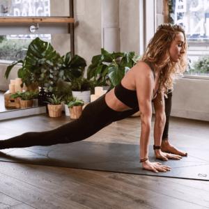 student exercising yoga